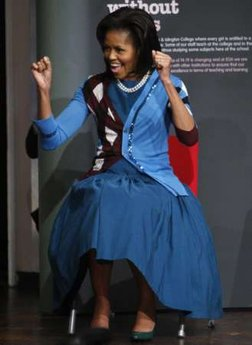 Michelle Obama in blue dress, argyle sweater
